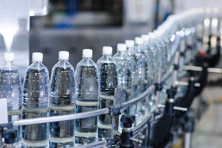 water bottles in production process on conveyor